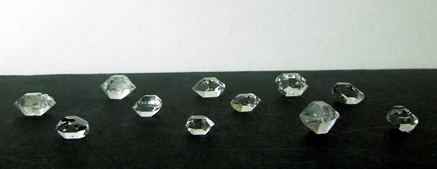 Crystals measure 7.5 - 12.75 mm