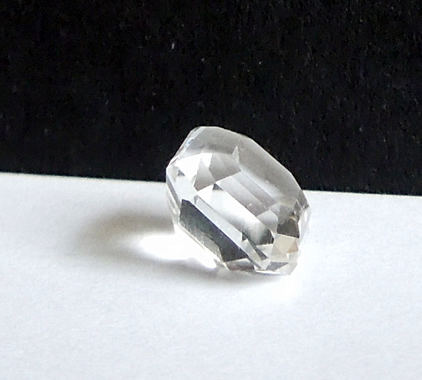 Side view of machine faceted Herkimer Diamond