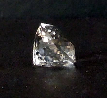 Side view of oval faceted crystal.
