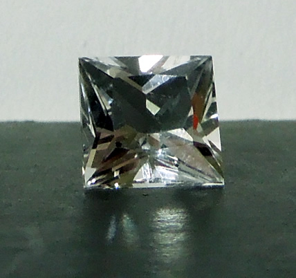Front view of cut crystal gemstone.