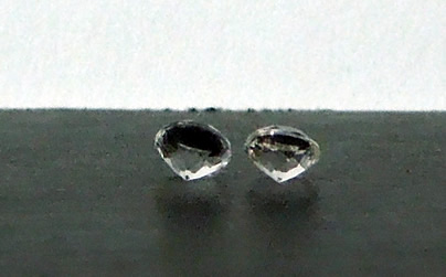 Pair of small Herkimer Diamond accent gemstones.