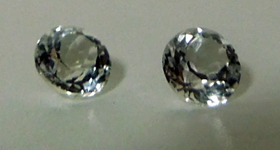 Front view of 5 mm round cut diamonds.