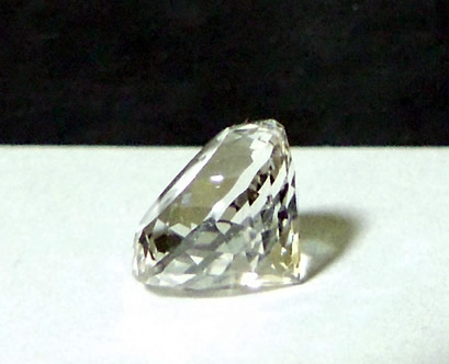 Side view of round star cut Herkimer Diamond crystal.