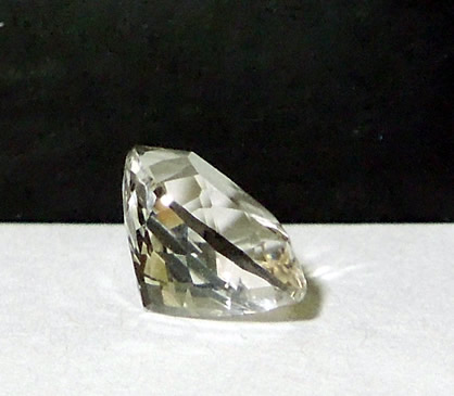 Side view of water clear cut quartz crystal.