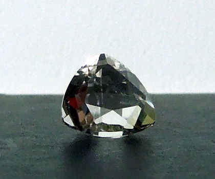 Front view of a trillion cut crystal gemstone.