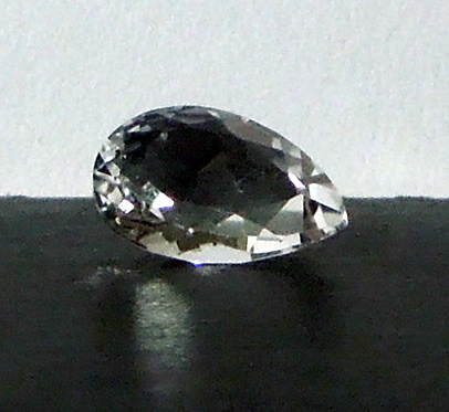 Front view of cut crystal, facets sparkle.