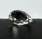 Images of a clear faceted Herkimer Tear Drop Crystal.
