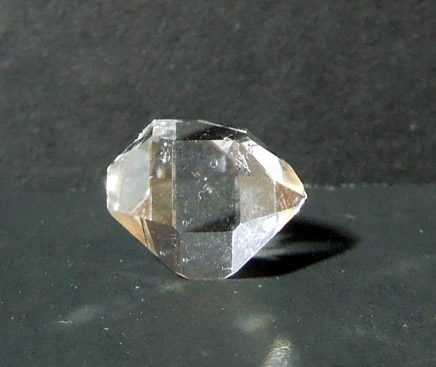 Photo shows the raw quartz crystal has a 'superman' shape.